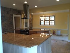Renovation of kitchen; added new custom cabinetry, new custom nature blend stone to match the existing home, and new Pella windows with blinds between the glass.