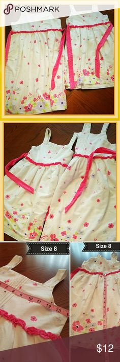 Little Girl's Matching Sundresses  Bundle two matching little girls Sundresses Sizes:  Child 14 & 8  Material: shell 100% cotton                  lining 80% polyester,                             20 cotton Preowned EUC George Dresses