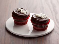Ellie Krieger re-creates a favorite childhood snack by topping low-sugar, part whole-grain cupcakes with a rich chocolatey layer and just a squiggle of cream cheese icing.