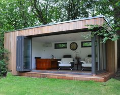 Wide bi-folding doors create a vast open space in this garden lodge Backyard Office, Backyard Studio, Garden Office, Garden Lodge, Garden Cabins, Summer House Garden, Casas Containers, Shipping Container Homes, Pool Houses