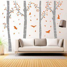 Vinilo decorativo vegetal de troncos de árboles con hojas cayendo y pajaritos de colores. ¡Ideal para convertir cualquier pared en un bosque!