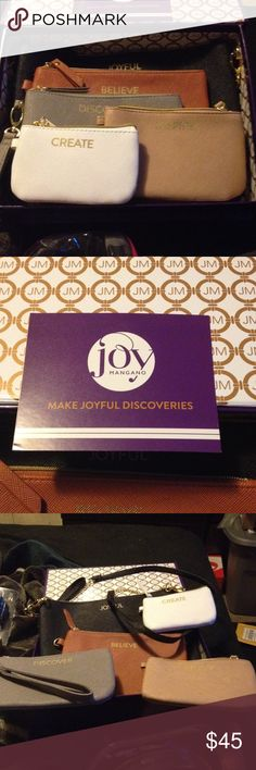 🎄Beautiful 5 piece Joy Mangano Crossbody/wallets This is a boxed set from Joy Mangano. All are inscribed w/ a word: Joyful, Believe, Discover, Inspire & Create.. All neutrel colors. 1 crossbody black with gold chain accents on strap and the rest are wallets and wristlets. Very nice materal. Brand new and would make a nice Christmas gift.. All have gold hardware. Joy Mangano Bags Clutches & Wristlets