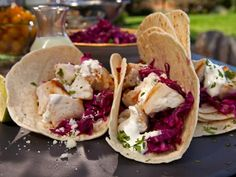 Get Guy Fieri's Grilled Tequila Lime Fish Tacos Recipe from Food Network