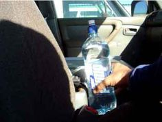 TRUE: Water bottle car fire hazard. . Given the right kind of plastic container and the right environmental conditions, sun shining through a water bottle can indeed lead to combustion. A round plastic bottle filled with clear water can act as a lens that concentrates the sun's energy on one point.