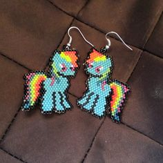 These super cute Rainbow Dash earrings are darling and perfect for the adult MLP fan in your life. With bright colors, and cartoon cuteness, you can't go wrong with these earrings. They measure about 1.75″ by 1.75″ and are super lightweight at only a few grams.  There are 450 individual beads in each earring, and they take a bit over an hour to make each one. I'll be adding other ponies soon! Just wait!