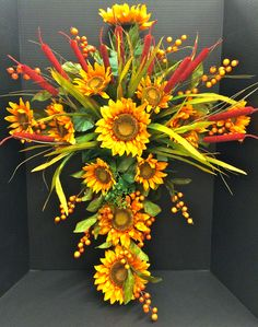 Faux Fall 2014 Season Grapevine Memorial Cross: Sunflowers, Cats Tails, Wild Grass Ivy and berries. Original design and arrangement by http://nfmdesign.synthasite.com/