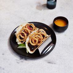 """First it was burgers. Then pizza. Now, American chefs are obsessed with tacos, perfecting classics and even creating Asian versions. F&W offers an extraordinary taco tasting, from hot spots like a California fish market with great seafood tacos to a self-proclaimed """"hillbilly dive"""" in Chicago."""