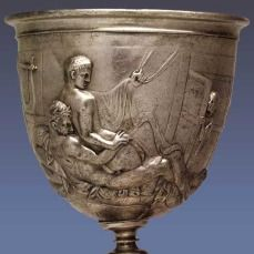 The Warren Cup, a 1st Century AD Roman banqueting cup, features two finely wrought low-relief sculptures of male couples making love. Once a closely guarded secret treasure, it now belongs to the British Museum.