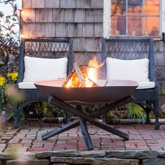 Hand-forged from solid iron, this rustic fire pit rests on a tripod of log-shaped legs. Each spacious fire pit is paired with a protective lid, so it
