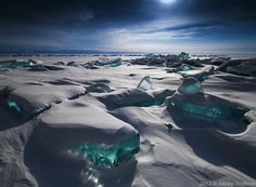 Beautiful Turquoise Ice Formations On A 20 Million-Year-Old Lake
