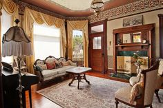 I love this Victorian parlor in an 1898 house. The parlor set, wallpapers and borders, lampshades and rug all very pretty. I question the artwork above the mantel; the way it sits doesn't feel Victorian and itself doesn't look Victorian. But the room is lovely.