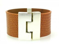 I own this bracelet ....in dark brown lizard.  It's a beautiful statement piece ....you need nothing else when you wear it.  It always draws attention and compliments.  Purchased it at an Austin boutique.