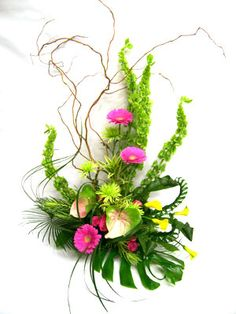 floral design by Lilies White. a large colourful arrangement containing bells of Ireland, gerbera daisies, calla lily and anthurium Tropical Floral Arrangements, Small Flower Arrangements, Small Flowers, Calla Lily, Ikebana, Event Ideas, Party Ideas, Wedding Flowers, Daisy