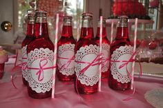 cute idea for a party. Any color of drink, paper dolie, ribbon, and straw. So easy