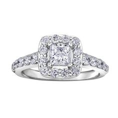 Bague de fiançailles sertie de diamants Canadiens totalisant 0.50 Carats - Chaque diamant est numéroté et certifié de pureté I. La couleur varie pour chaque diamant. Toutes les informations sont sur le certificat d'origine - en Or blanc 14K