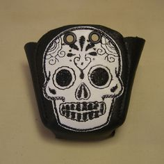 Black leather Roller Derby Skate toe guards with white Sugar skulls. £25.00, via Etsy.