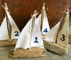 4 Handmade Driftwood Sail Boats  6 to 8 by SaltyGirlandLongDog. Driftwood and natural decor for beach or rustic weddings. Driftwood sailboats for wedding table markers. http://saltygirlandthelongdog.com/
