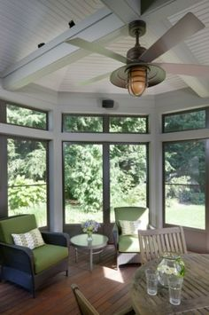 Sunroom - I like the ceiling and fixture. Dave likes the white wood.