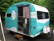 Gypsy Living Traveling In Style. Vintage Wagon, Caravan, or Travel Trailer. Exterior Turquoise.