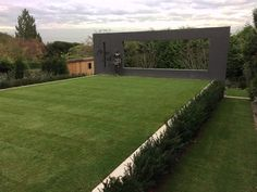 Feature wall with formal lawn flanked by taxus hedging. Regardt vander Meulen statue Weathered and bespoke cedar shed with sedum roof
