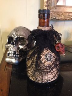 Potion bottle for a witch vignette. Jute string wrapped bottle with creepy cloth overlay. Skull bread. Simple!