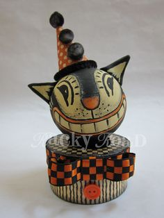 Let's make Halloween cats!     Here's what you need:    a round paper maché ornament and a paper maché box, black and orange scrapbook paper...