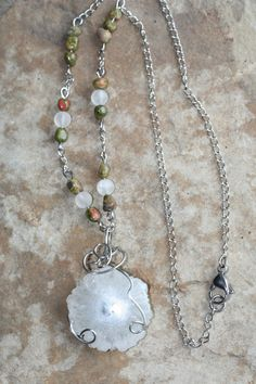 Solar Quartz & Crackle Quartz are energy enhancers that connect to spirit & harmony, bring about emotional strength, while uplifting with great power & energy. Like Clear Quartz, Solar Quartz is protective, purifying on spiritual, mental & physical levels & is used to communicate with spirits. It is associated with the Crown Chakra, but works on all Chakras. Unakite tempers & enhances the Quartz with its soothing & gentle energy, bringing in unconditional love, connection & reunion.