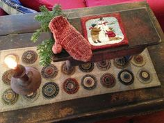 Country Keepers   Primitive Handmades Mercantile ~ Love the penny rug in the photo