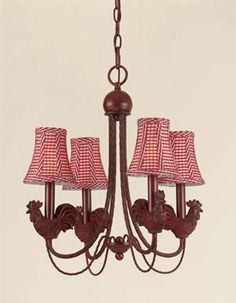 Antique iron roosters with red checkered shades complete this charming chandelier. The graceful lines of this lighting fixture make it a true statement piece. Mini Chandelier, Chandelier Shades, Lamp Shades, Chandelier Lighting, Rooster Kitchen, Boutique Decor, Rooster Decor, Iron Chandeliers, Antique Iron