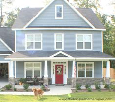 Love the little angle above the front door. blue-gray siding and bright red front door (Sherwin Williams Pompeii Red) House Paint Exterior, Exterior House Colors, Exterior Doors, Light Blue Houses, Grey Houses, Houses With Red Doors, Brick Houses, Cat Houses, Red Door House