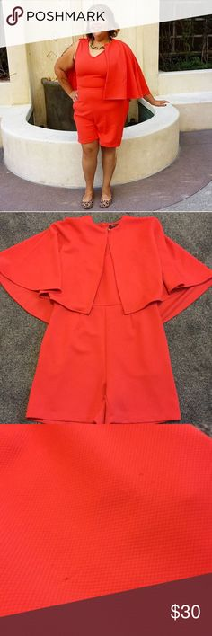Cape romper in coral red Light wear. Pockets! Back zipper. A little stretch. Fits a 14/16. Label size 1. Monif C. Pants Jumpsuits & Rompers