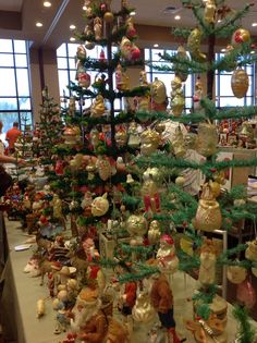 Antique glass Christmas ornaments, on display on Feather Trees, at the Golden Glow wonderland. 2014 convention Chicago, Illinois.