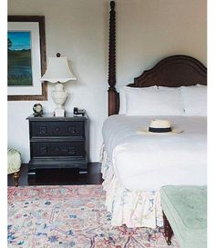 """Traditional with a Twist: @waitingonmartha -- Our favorite aspect of this room? The pops of pastels with the dark wood furniture. An expert way to do this is to add pieces with both color and texture, like a tufted ottoman at the foot of the bed and faded pink Persian rug underfoot. Bonus: the carved four poster bed! Shop the pieces you need to get the look and see more bedroom interior design inspiration in """"9 Inspiring Instagram Bedroom Ideas to Steal"""" on the One Kings Lane Style Guide!"""