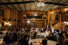 The room fills up nicely with guests inside the Polo Barn Sydney Polo Club Winter Wedding. Photography: Sutoritera