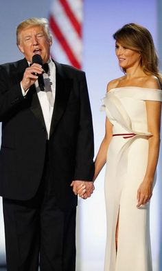 Donald Trump admired his wife while speaking to the crowds at both balls.
