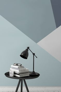 Combining beautiful sleek lines with a muted palette of steel blues. This geometric wallpaper design brings a touch of class and sophistication to any interior. Accessorise with minimal furniture and create a contemporary feel to your home.