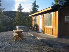 Cabins feature a private hot tub and barbeque patio