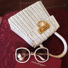 9901250fba59 Tastemaker Gilda Koral Flora accessorizes with a Ferragamo white woven  handbag and #FerragamoBuckle sunglasses.