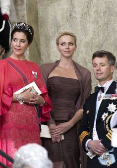 Princess Charlene of Monaco departs the royal chapel with Crown Princess Mary and Crown Prince Frederik of Denmark; wedding of Princess Madeleine of Sweden and mr Christopher O'Neill on June 8, 2013
