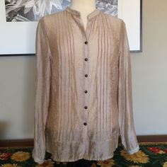 Beautiful Coldwater Creek Top Coldwater Creek long sleeved top in lightweight fabric. Pleated front and back with button front. Tencel/nylon, machine washable. Very good condition. Coldwater Creek Tops Blouses