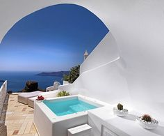 The luxury Hotel Tholos overlooks the Mediterranean Sea.