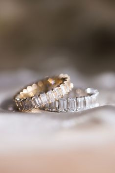 Earth or Lab!? You tell us! Here we have two of our Emerald Cut Eternity Bands. You won't want to take these off! The band showing in 14k yellow gold is created with Lab Grown Diamonds and the band showing in 14k white gold is created with Earth Mined Diamonds.