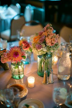 Mason Jar Wedding Centerpiece http://www.marketplaceweddings.com/blog/centerpieces-for-weddings-unique-favors-centerpiece/