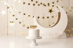 simple gold stars cake smash set up for first birthday photos