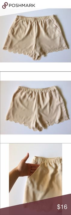 """Lauren Conrad scalloped shorts Excellent used condition   Sweet light blush color   Pockets on both sides!   Size small   3"""" inseam   from waist to hem is 13""""   Elastic waistband   100% polyester LC Lauren Conrad Shorts"""