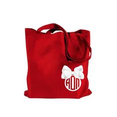 Alpha Omicron Pi tote bag with white Greek monogram and bow.