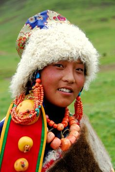 Asia   Portrait of a Ngolok, Golok girl wearing traditional clothes, sheepskin hat hat and coral necklaces, Amdo, Tibet #beads