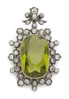 A peridot and diamond brooch/pendant necklace, circa The large cushion-shaped peridot, within a foliate surround of cushion-shaped diamonds Victorian Jewelry, Antique Jewelry, Vintage Jewelry, Gemstone Brooch, Diamond Brooch, Diamond Choker, Gold Brooches, Vintage Brooches, Couleur Chartreuse