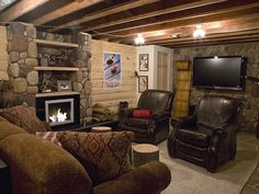 Cozy Ski Lodge  This winter-sports fan no longer has to leave the comforts of his home to enjoy the great outdoors. He now has a sporty ski lodge in his basement, complete with blended river rock, working fireplace, waterless urinal and authentic quarter-round siding that adds a touch of the mountains to any home.