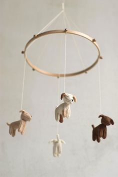 Puppies are knitted from wool yarn. They are done slowly, in peace and with love. They are filled with natural wool. Puppies hang on beech tree hoop (10 in diameter). Mobile is decorated with copper color tiny bells. I can knit puppies for your nursery in custom color. Just convo :) Puppies stand on their feet too. So it is possible to play with them later :) size on dogs is ~2.7 in It is perfect gift for new coming baby and his parents :) thank you for visiting